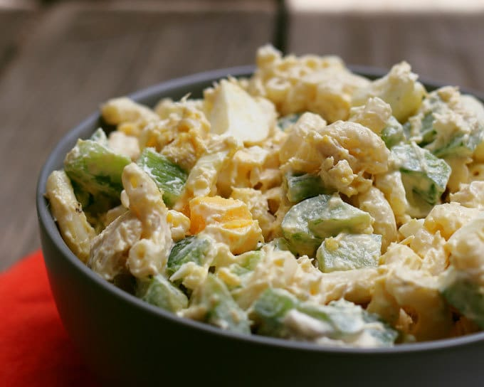 close up photo of boiled egg tuna macaroni salad