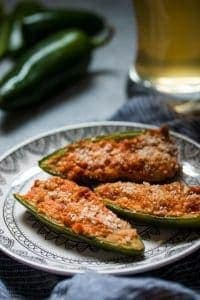 baked jalapeno poppers with a glass of beer