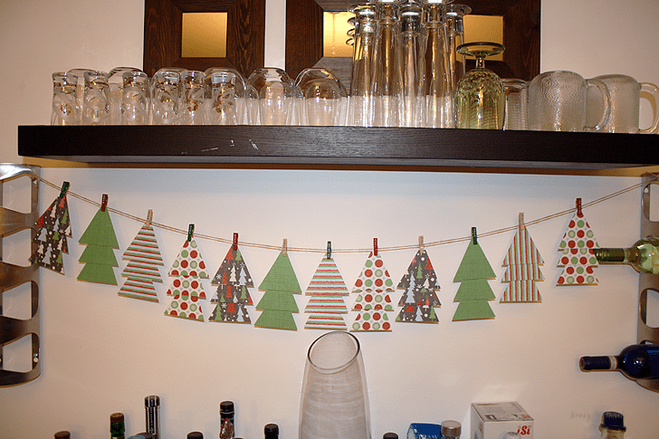 If you're looking for an easy holiday decoration, try this DIY! | Christmas Scrapbook Paper Tree Garland | www.honeyandbirch.com