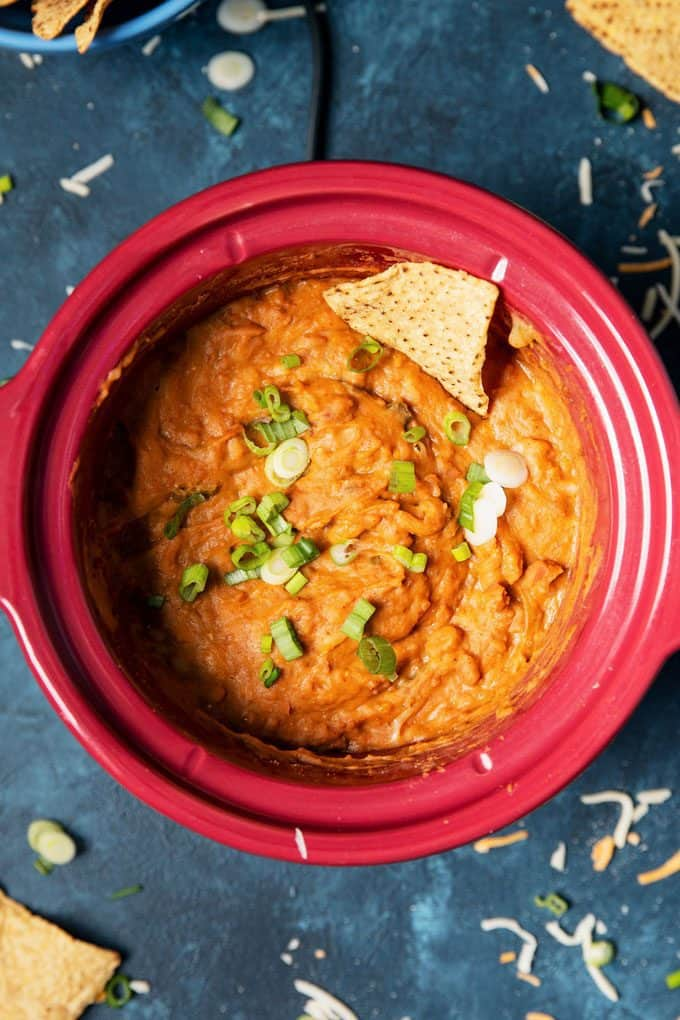 slow cooker bean dip in a red slow cooker