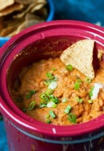 slow cooker bean dip with a chip