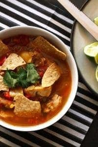 This chicken tortilla soup is easy to make thanks to pre-cooked chicken - you can even use a rotisserie chicken. It is full of vegetablesand spice!
