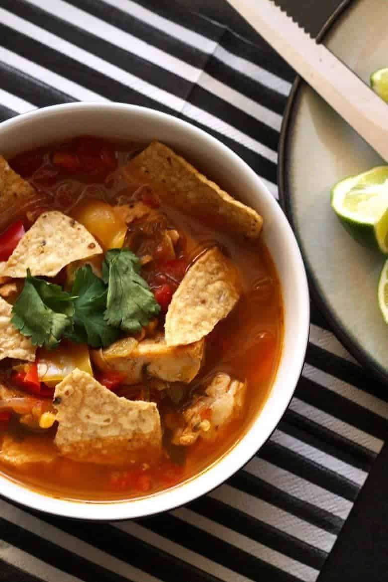 This chicken tortilla soup is easy to make thanks to pre-cooked chicken - you can even use a rotisserie chicken.  It is full of vegetables and spice!