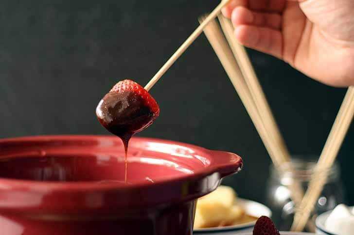 This slow cooker chocolate fondue recipe is perfect for a romantic night or a Valentine's Day celebration. | honeyandbirch.com