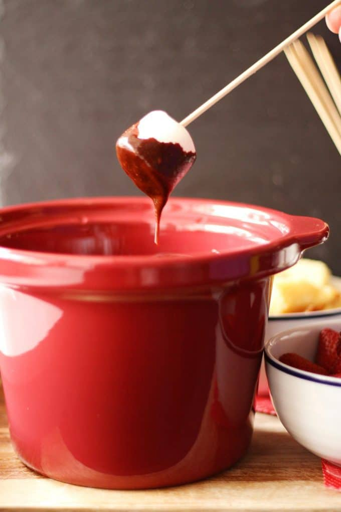 marshmallow dipped into chocolate fondue
