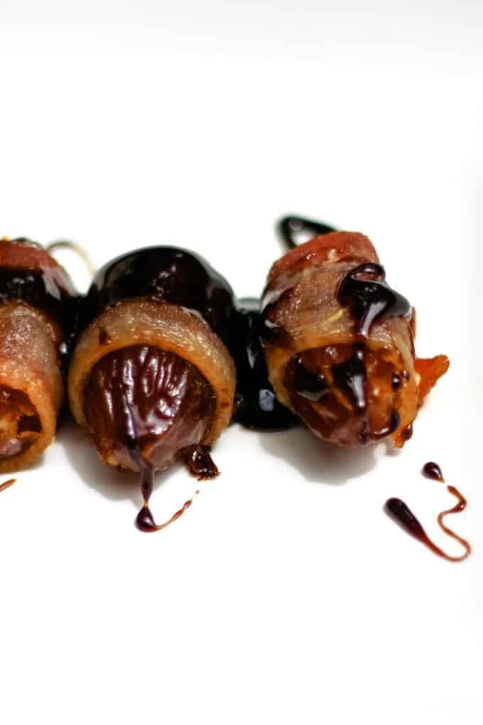 2 bacon wrapped dates with balsamic reduction