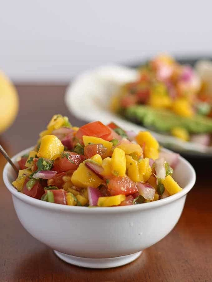 Mango pico de gallo - perfect on top of fish tacos! Also, great for dipping chips, inside a steak burrito or on top of a burger. | honeyandbirch.com