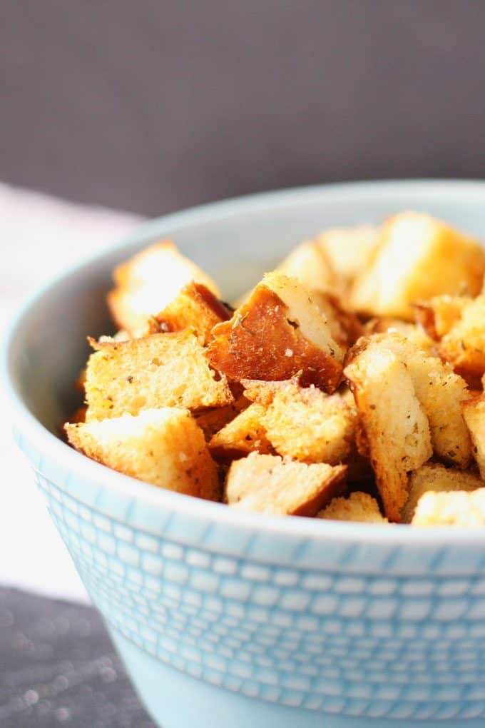 homemade croutons in a blue bowl