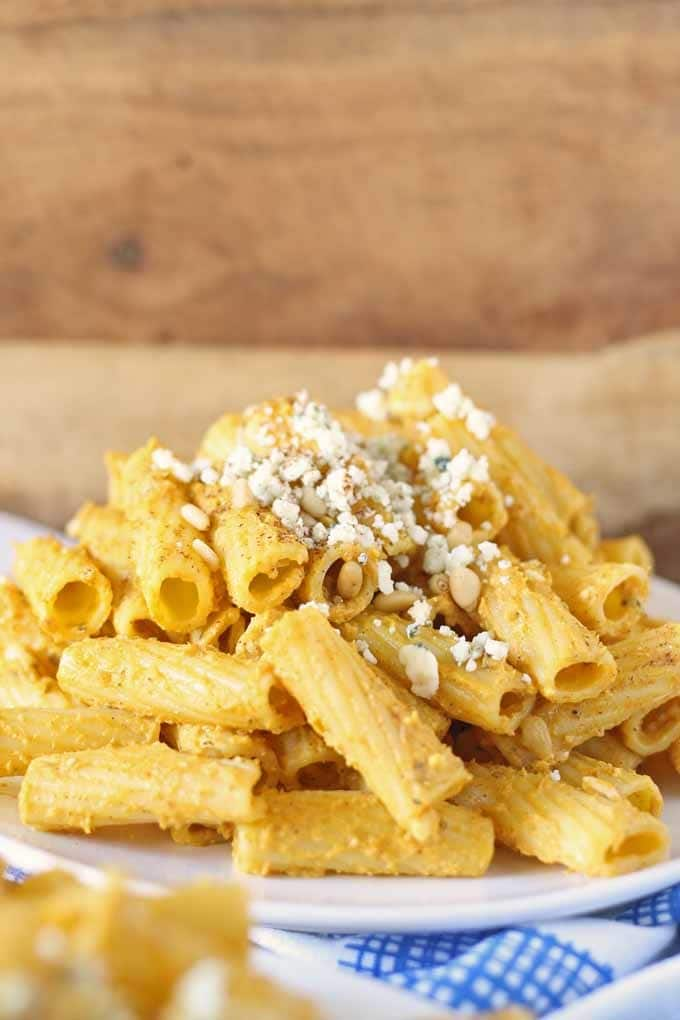Pasta with Pumpkin Sauce.  Topped with pine nuts and gorgonzola cheese | Honey and Birch #pumpkin