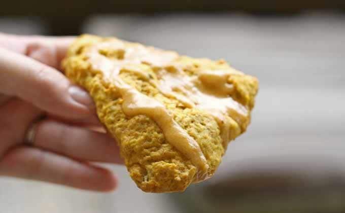 Pumpkin spice scones being held