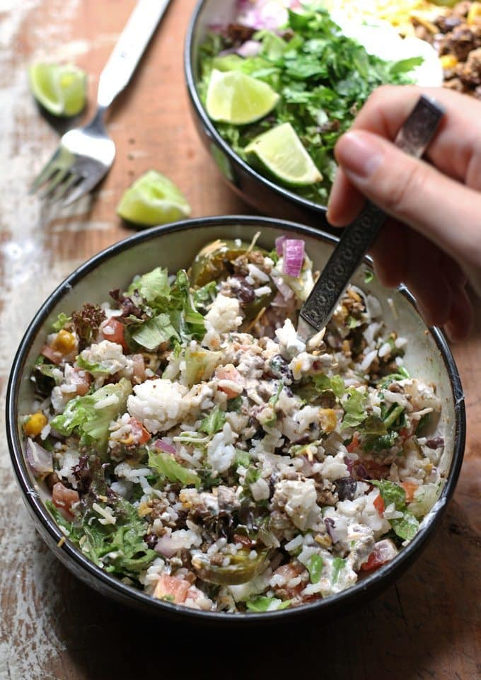 This recipe for loaded burrito bowls will hit the spot if you have picky eaters or need to eat dinner quick. Load the table with a variety of burrito fillings to make this everyone's favorite! | www.honeyandbirch.com