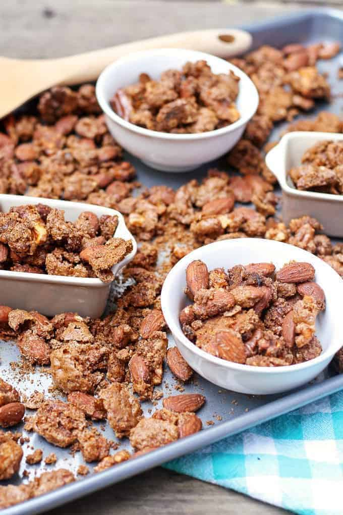 pumpkin pie spiced nuts on a metal tray in bowls
