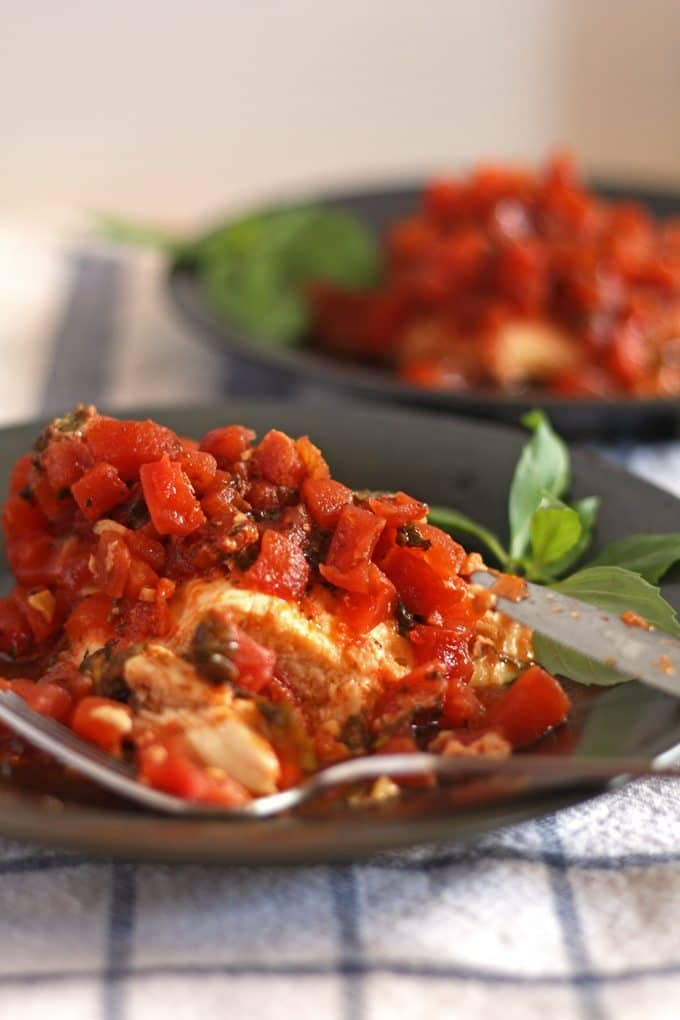 Get dinner on the table for your family with this an easy recipe for slow cooker bruschetta chicken!
