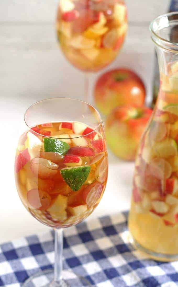 White wine apple cider sangria is the perfect addition to fall brunches. Grab your ingredients and try this recipe today! | honeyandbirch.com