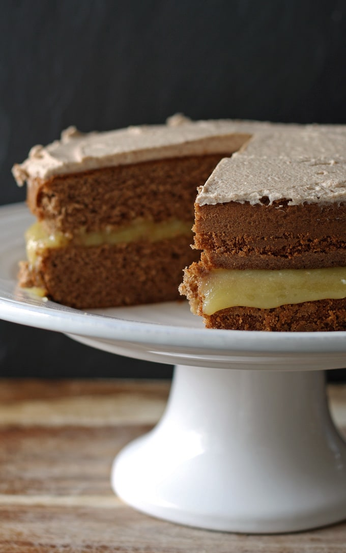 This spice cake has an apple curd filling and is topped with cinnamon marscapone frosting. It is perfect for fall and Thanksgiving! | www.honeyandbirch.com