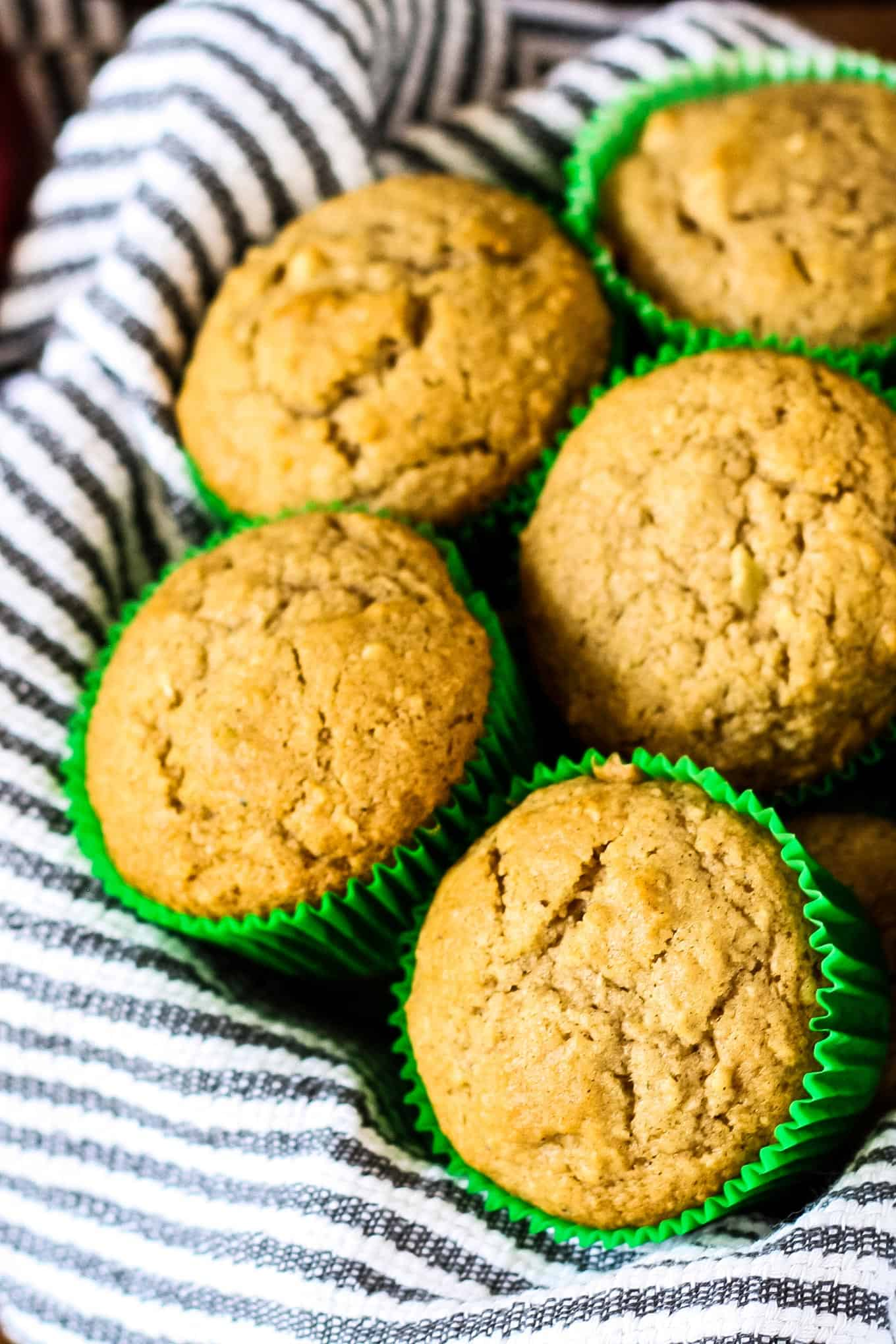 spiced apple muffins in a basket