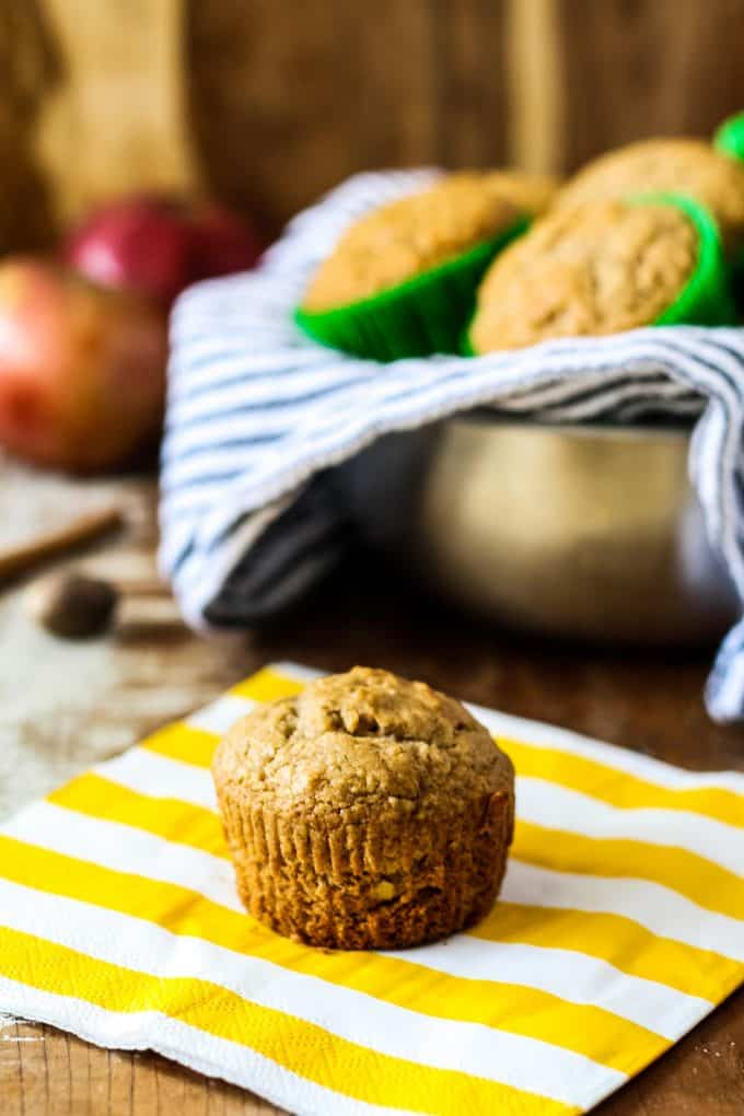 one spiced apple muffin on a yellow napkin