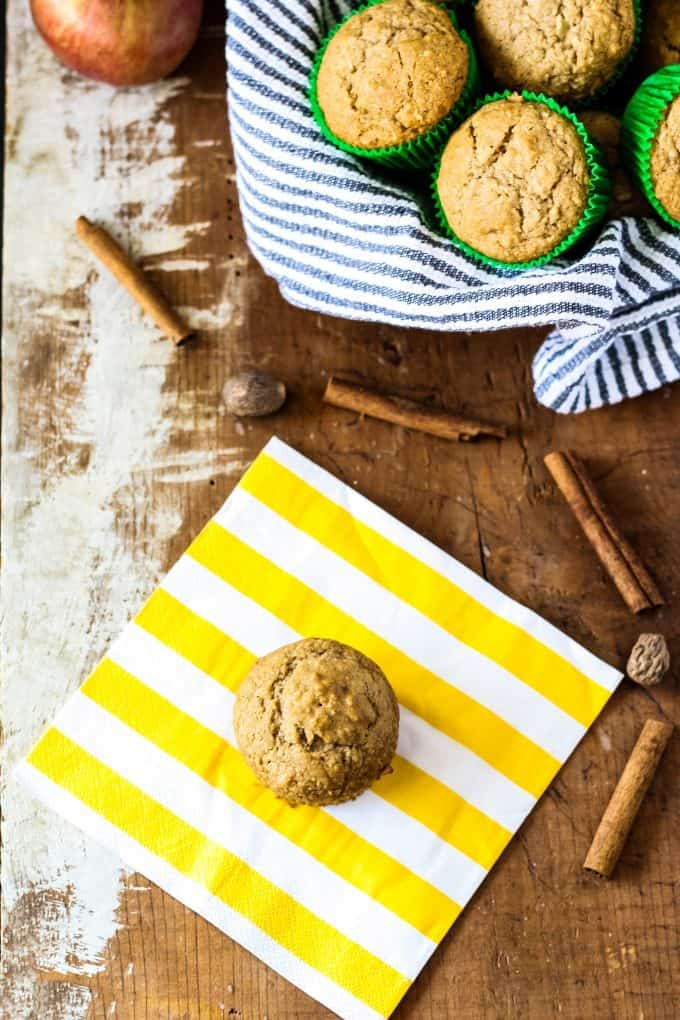 spiced apple muffin and a basket of apple muffins