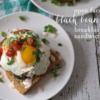 Looking for a delicious recipe for an at-home brunch? Try this recipe for open face black bean cake breakfast sandwiches! | www.honeyandbirch.com | #brunch #breakfast #vegetarian