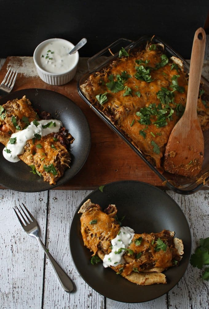 Black Bean Enchiladas with Jalapeno Crema | www.honeyandbirch.com #mexican