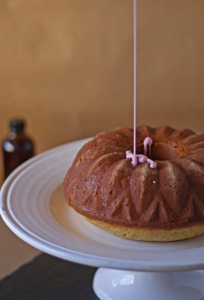 Vanilla Bean Bundt Cake with Pomegranate Glaze | www.honeyandbirch.com