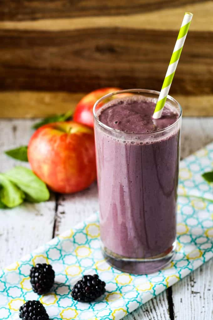 blackberry apple smoothie with a green straw