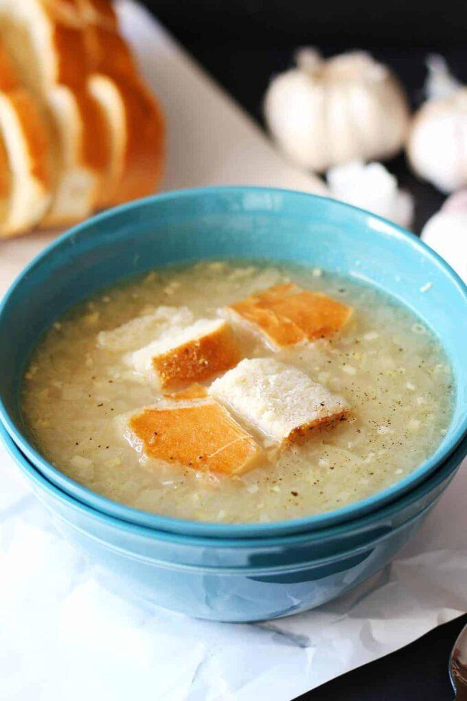 garlic soup in a blue bowl