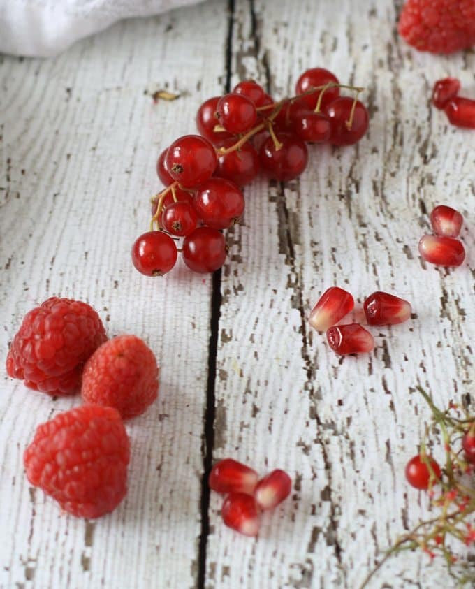 Red Fruit Salad | Sweet and tart, full of raspberries, pomegranate and red currant! www.honeyandbirch.com #fruit #salad