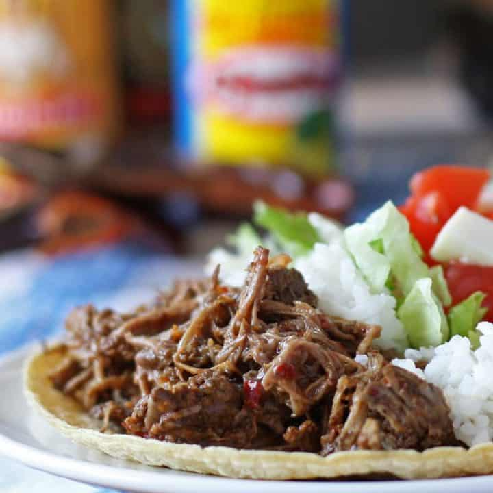 Make this slow cooker coffee barbacoa beef the next time you are in the mood for tacos, burritos or quesadillas! If you're looking for game day recipes, this is the perfect dinner! | honeyandbirch.com