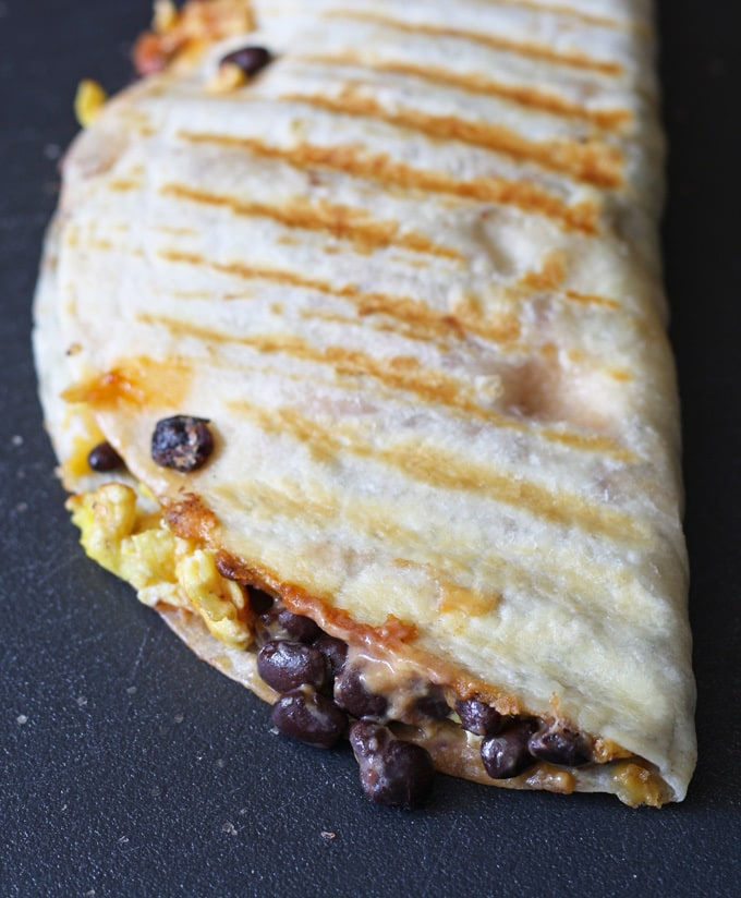 This easy breakfast quesadilla is a great way to start your day - full of eggs, black beans and cheese! Only 10 minutes to cook. | www.honeyandbirch.com