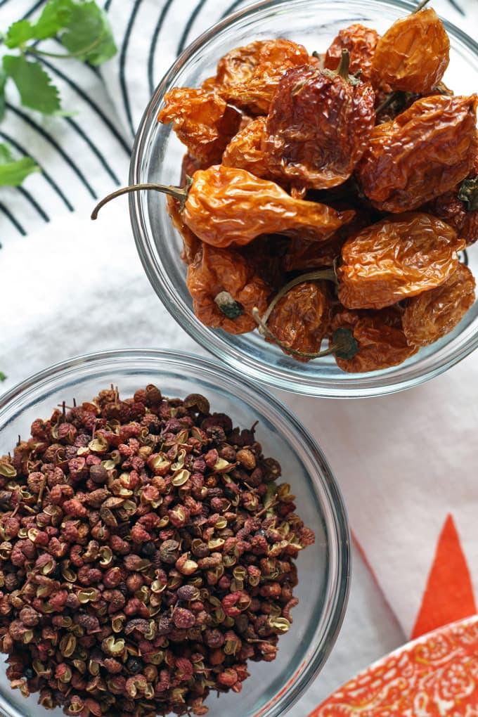 Fire Chicken Recipe - the perfect blend of Szechuan peppercorns and dried habanero peppers! | www.honeyandbirch.com #spicy #dinner