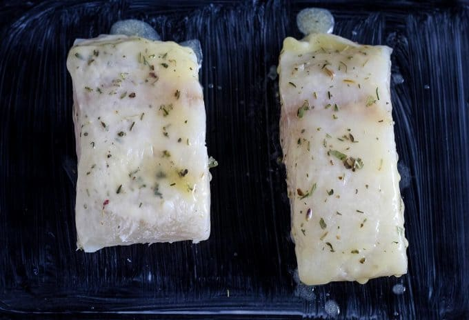 cooked halibut in a glass baking dish