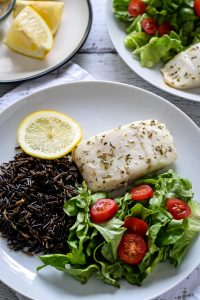 easy baked alaskan halibut with wild rice and a small salad