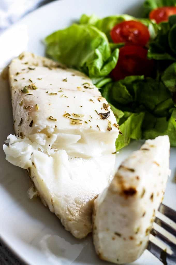 cooked alaskan halibut on a fork
