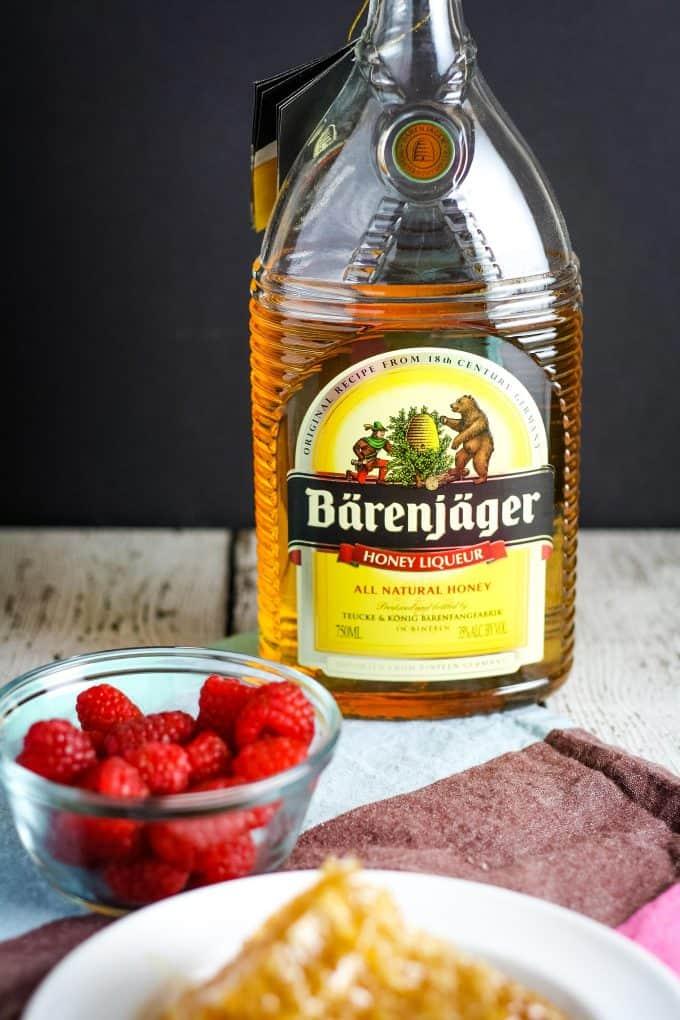 bottle of Bärenjäger with raspberries