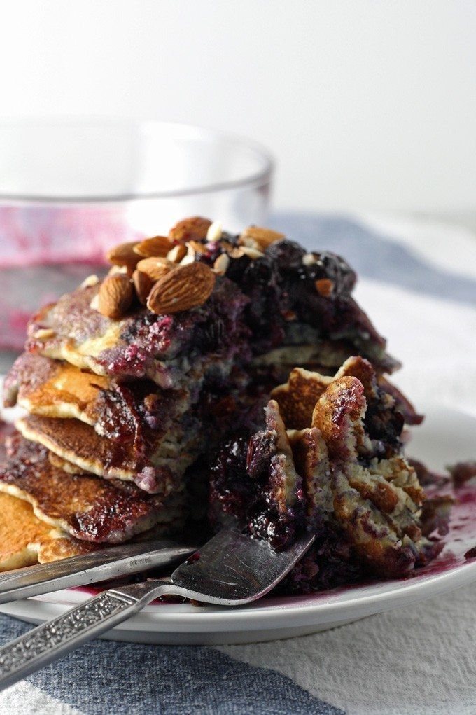 Start your day with these delicious blueberry almond pancakes, topped with homemade honey poached blueberries. Perfect for breakfast!   honeyandbirch.com
