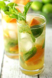 two orange mojitos in clear glasses