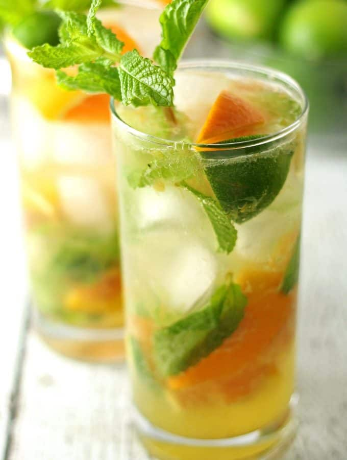 two orange mojitos in clear glasses