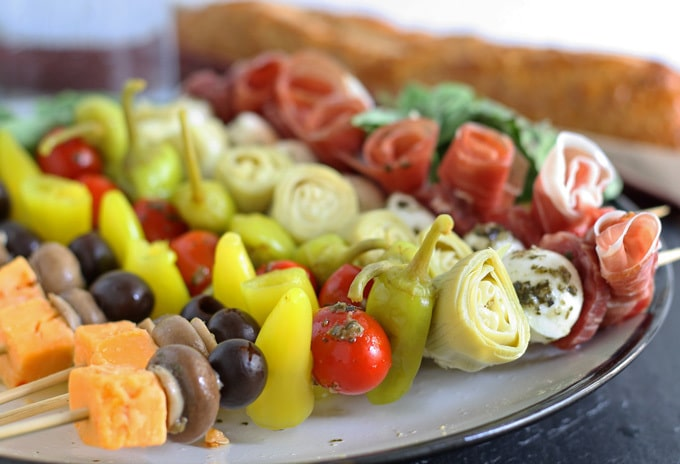These antipasto skewers are the perfect lazy day Italian appetizer. They can easily be made from store bought pickled items or from your pantry stash! | honeyandbirch.com
