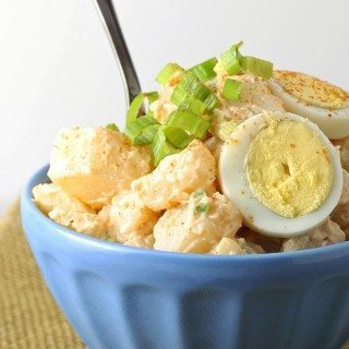 Try this easy potato egg salad! It is the perfect side dish for your next BBQ and all of the summer holidays: Memorial Day, 4th of July and Labor Day! | honeyandbirch.com