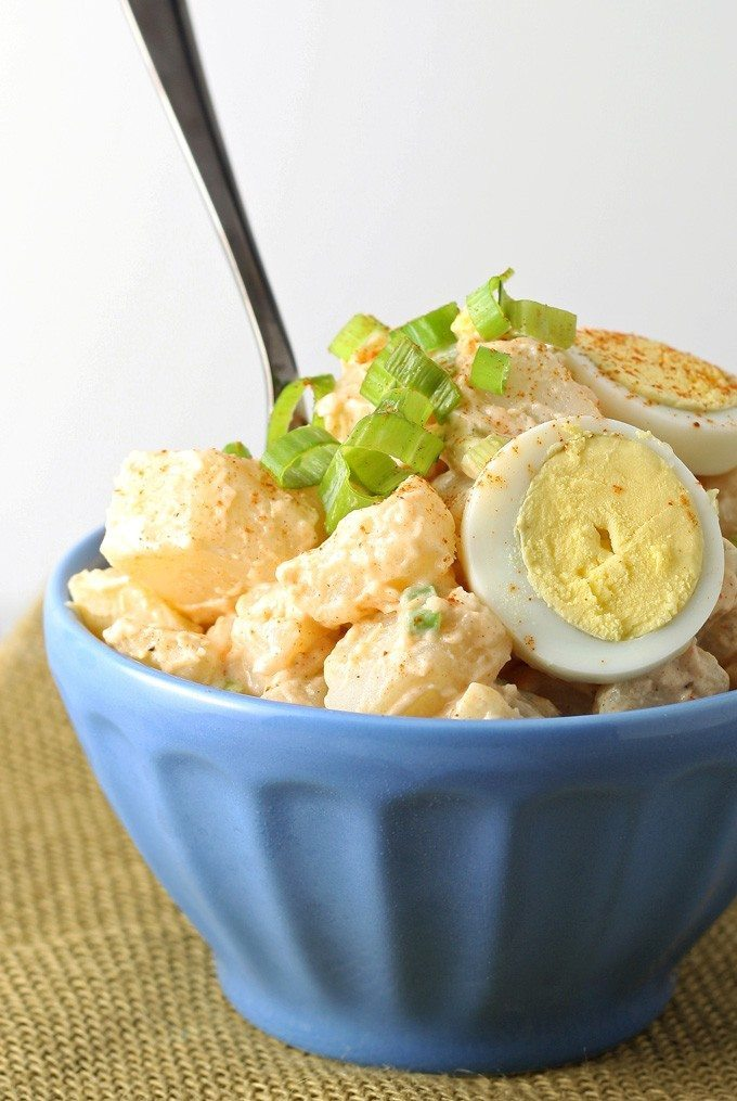 potato egg salad in a blue bowl