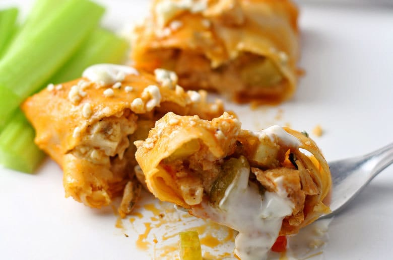 These baked buffalo chicken egg rolls are great as an appetizer or lunch! Pair them with blue cheese dressing and extra buffalo sauce! If you're looking for game day recipes, this is the perfect appetizer! | honeyandbirch.com