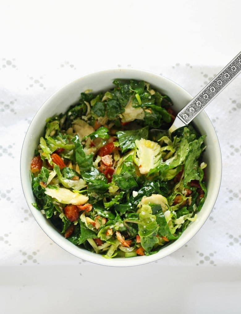 This Brussels sprouts kale salad with bacon, almonds, blue cheese and a lemon garlic vinaigrette is perfect for lunch or a light dinner!