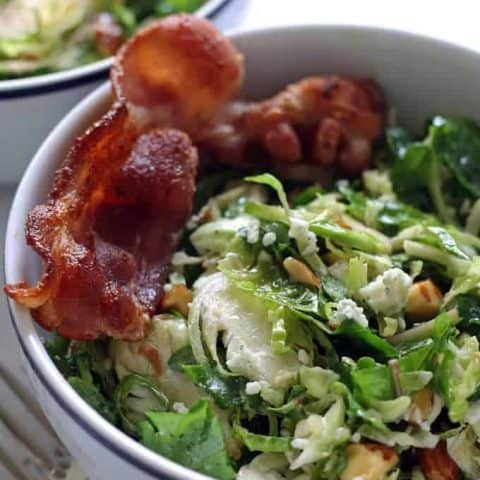 Brussels sprouts kale salad with bacon, almonds, blue cheese and a lemon garlic vinaigrette. Lunch is served! | honeyandbirch.com