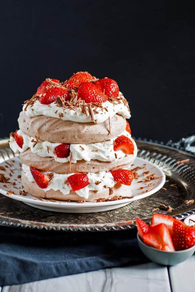 chocolate pavlova cake with strawberries and whipped cream