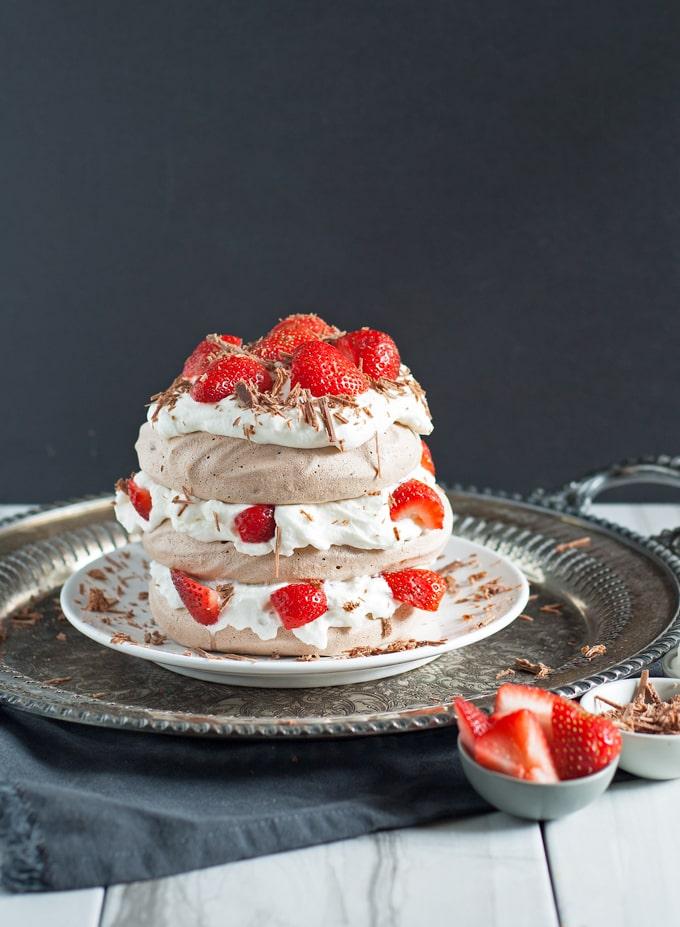 Chocolate Pavlova Cake - delicious chocolate meringue layered with whipped cream and fresh strawberries. | honeyandbirch.com