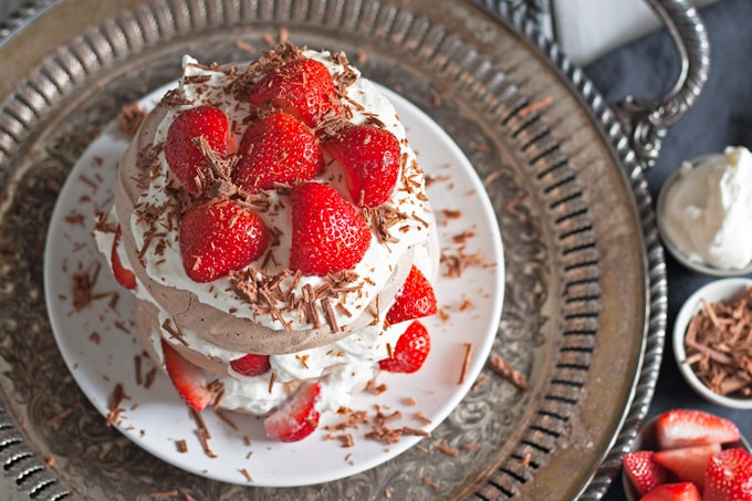 Chocolate Pavlova Cake - delicious chocolate meringue layered with whipped cream and fresh strawberries. | honeyandbirch.com