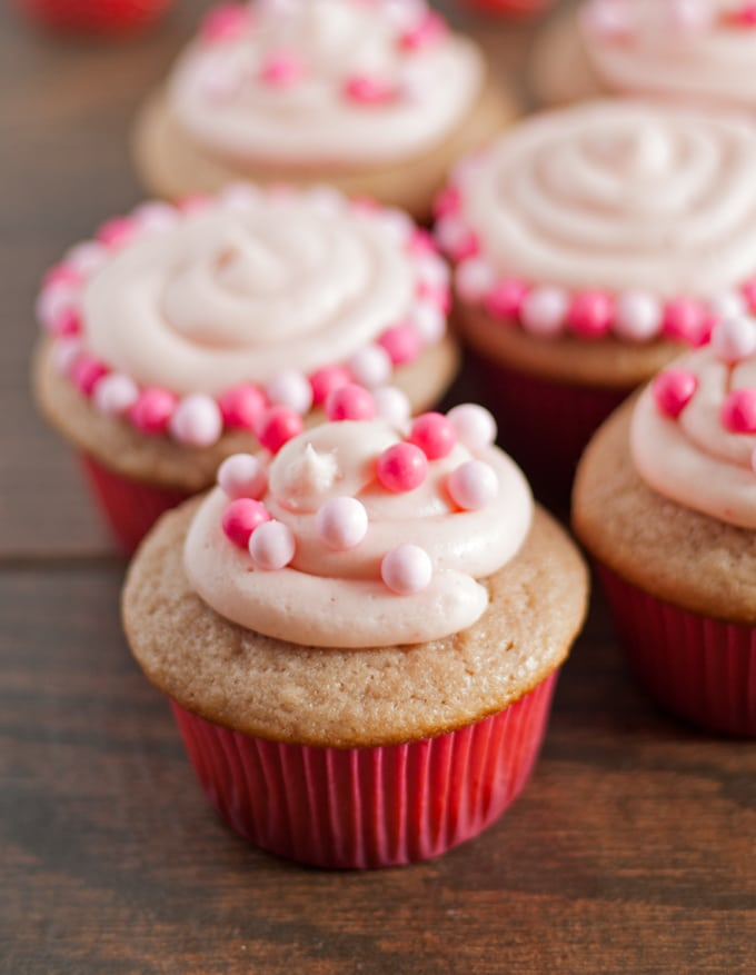 Double Berry Cupcakes - both the cupcakes and frosting are made with a mixture of raspberry and strawberry puree! | honeyandbirch.com