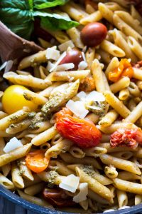 pan filled with tomato and pesto pasta