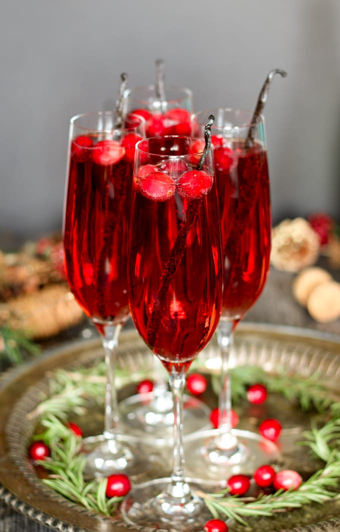 photo of vanilla cranberry mimosas garnished with vanilla beans